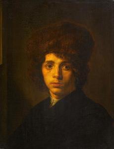 Portret van een jonge man met bontmuts