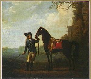 Een ruiter met een paard in een landschap