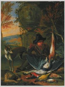 Een jager met twee honden bij jachtbuit in een landschap