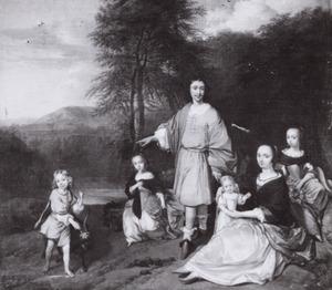 Groepsportret van een familie in een landschap