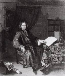 Portret van een jonge man in zijn studeerkamer