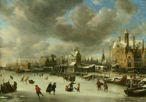 Het Paalhuis en de Nieuwe Brug te Amsterdam met ijsvermaak op het IJ