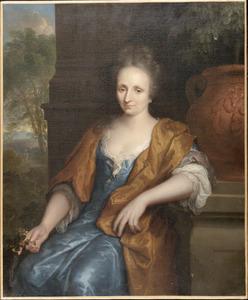 Portret van een vrouw in een tuin