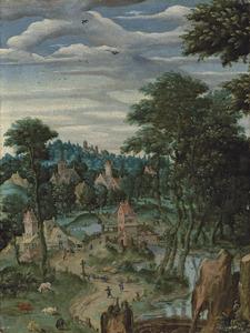 Dorpsgezicht met een watermolen en een kerk