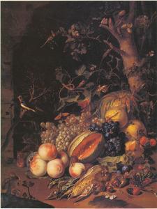Vruchten en vogels onder een boom voor de ingang van een grot