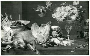 Een stillleven met jachtbuit en fruit op een tafel