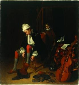 Interieur met een man die zijn laarzen aantrekt