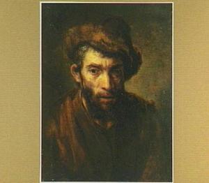 Bebaarde man met een bontmuts