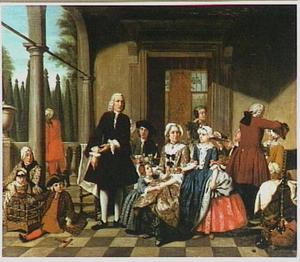 Familie aan de maaltijd op een terras