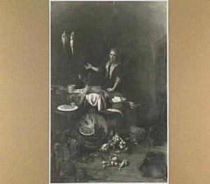 Keukeninterieur met meid bij een tafel met kreeften en asperges