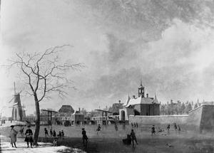 De Singelgracht met de Leidsepoort in Amsterdam in de winter