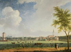 Gezicht op Den Haag vanaf de Laan van Schuddegeest met links de Beekmolen en rechts de Grote of St. Jacobskerk