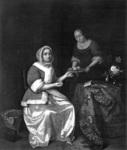 Jonge vrouw en een dienstmeid met een schaal met fruit