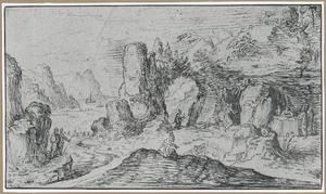 Rotslandschap met pelgrims bij een grot