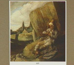 Man die vlooien aan het vangen is, zittend bij een hek