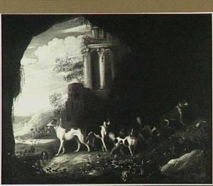 Jachthonden in een grotingang; op de achtergrond een ruïne