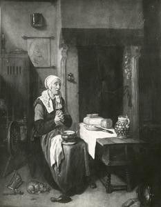 Biddende vrouw aan tafel, in een interieur