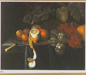 Stilleven met druiven en citrusvruchten