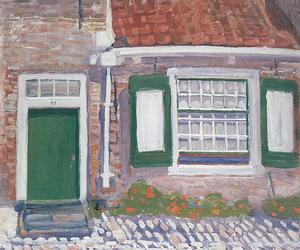 House façade with green trimmed shutters
