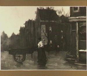 Vrouw met handkar in de straten van Amsterdam