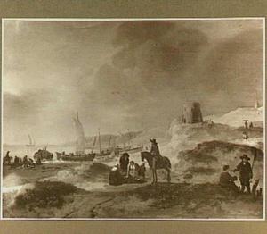 Strandgezicht met schepen en figuren