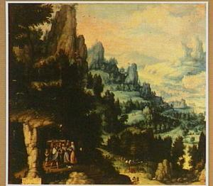 Berglandschap met figuren bij een grot