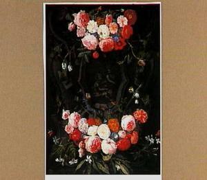 Bloemen rond een relief met het Christuskind, Johannes de Doper en het Lam Gods