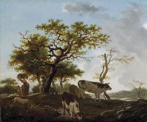 Jonge vrouw en herder in een landschap