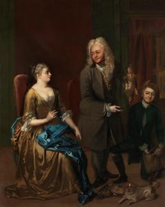 Man toont de jachtbuit aan een jonge vrouw