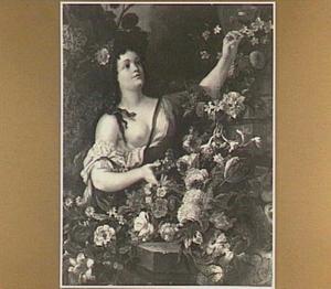 Jonge vrouw temidden van bloemen