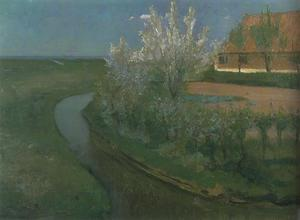 Curved irrigation ditch bordering farmyard with flowering trees
