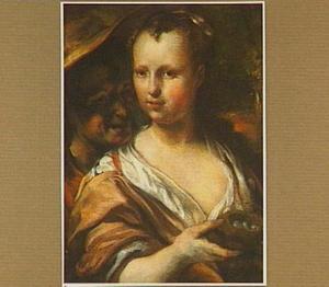 Een jonge man en een meisje met een vogelnestje in haar hand