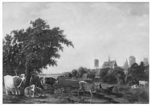 Weidelandschap met een melkmeid en koeien en  op de achtergrond Wijk bij Duurstede;