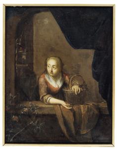 Vrouw in een raamnis met vogelkooi
