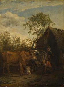 Jonge melkmeid met koeien voor een schuur