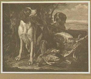 Twee honden bij een buit van gevogelte en een haas
