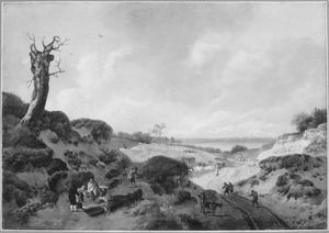 Duinlandschap met reizigers en zigeuners