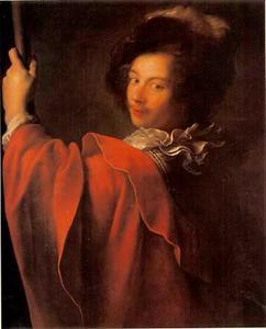 Halffiguur van een jonge man in fantasiekostuum met lans