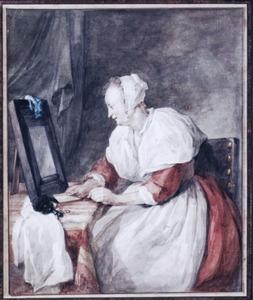 Vrouw zittend aan een toilettafel met spiegel