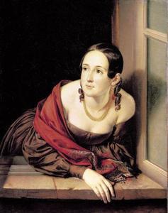 Jonge vrouw in een venster leunend