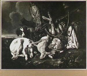 Honden en valk bij jachtbuit in een landschap