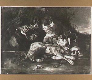 Twee honden bij een buit van haas en patrijzen in een landschap
