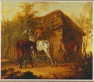 Ruiter en paarden bij een stal