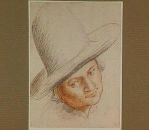 Kop van een jongen met hoge hoed