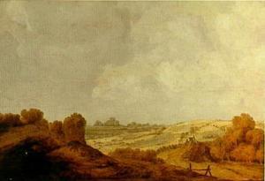 Duinlandschap met twee figuren bij een palissade