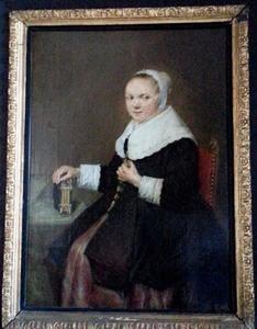 Portret van een vrouw, zittend aan een tafel
