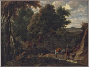 Boslandschap met drinkende koeien bij een drenkplaats en een ruiter met pakpaarden