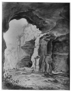 Grot met herder en vee in een rots