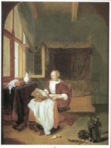Lezende jonge vrouw bij een open venster