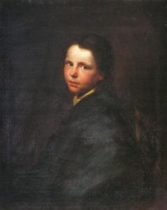 Portret van een jongen in een blauwe jas